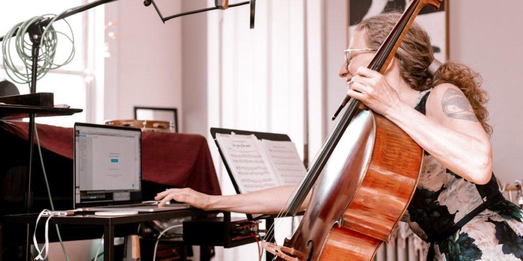 music teacher with software giving class